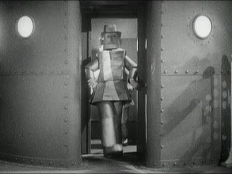 1940s black and white medium shot robots staggering through doorway / one getting stuck in the door / AUDIO