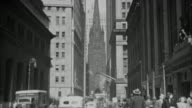 1940s B/W MONTAGE Buildings and traffic on Wall Street / New York City, New York, USA