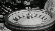 1940s close up roulette wheel spinning at casino table