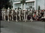 1940s MS, COMPOSITE, US army jeep and group of soldiers marching in parade, Elkins, West Virginia, USA