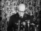 B/W 1940s General Dwight Eisenhower in eyeglasses giving speech about NATO into microphones