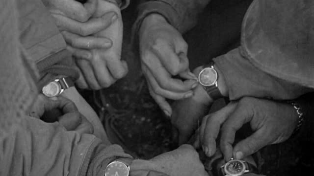 1940s medium shot Hands synchronizing five watches
