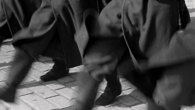 1940s medium shot tracking shot Legs of soldiers marching in a line