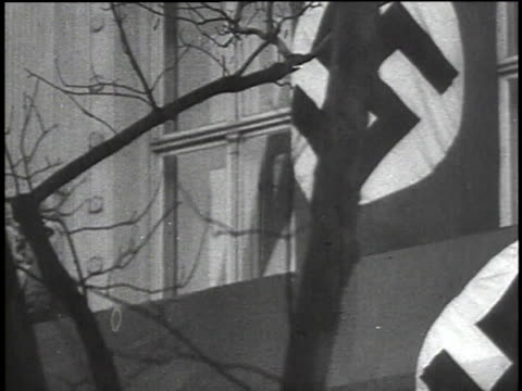 1940s MONTAGE Crowds chanting while Hitler approaching podium / Austria