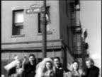 1940s MONTAGE three sets of newlyweds celebrating on a street corner / Brooklyn, New York, United States