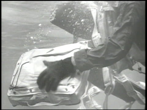 UNITED STATES NAVY VS Downed US Navy pilot in water Pacific Ocean hands underwater opening lifeboat raft pilot launching raft climbing onto raft WWII...