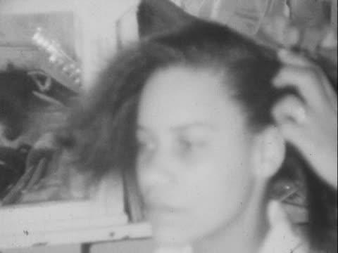 1940s/1950s MONTAGE B/W Women having their hair styled in hair salon/ Greenwood, Tulsa, Oklahoma, USA