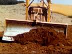 1950s bulldozer pushing dirt towards camera / audio