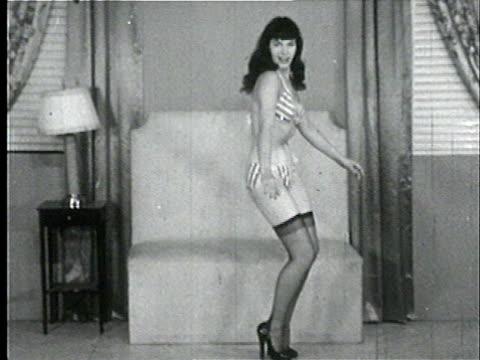 1950s B/W ZO WS ZI TD TU Model, Bettie Page, dancing in bikini and stockings/ USA