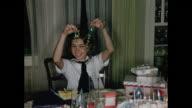 1950s girl opening birthday presents HOME MOVIE