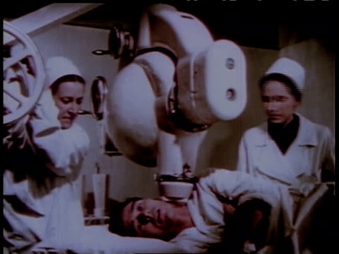1950s MS Male patient receiving radiation therapy on a tumor on his neck / Russia