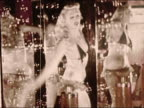 1950s Medium shot burlesque dancer wearing bra and panties dancing surrounded by bubbles and mirrors / Coney Island / Brooklyn, New York / AUDIO