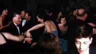 1950s medium shot group of couples dancing in ballroom