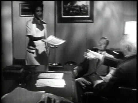 1950s MONTAGE two men and a secretary in an office/ United States