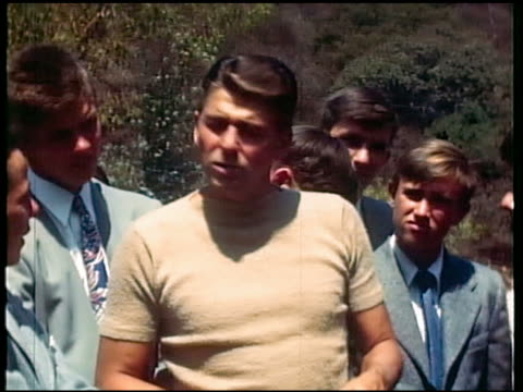 1950s Ronald Reagan talking to group of teenage boys
