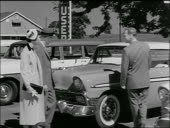 Bw 1950s Salesman Showing Chevrolet To Couple At Used Car Dealership Stock Footage Video