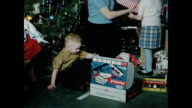 1950s Young Girl playing with rocking horse on Christmas day HOME MOVIE