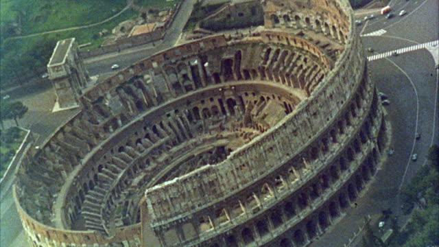 1960s AERIAL WS Coliseum exterior / Rome, Italy