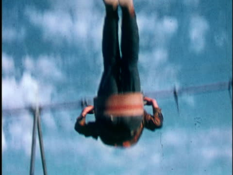 1960s CU, Boy (10-11) swinging on swing, Bristol Bay, Alaska, USA