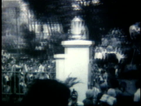 1960s B/W WS PAN Large crowd of South Vietnamese people gathered outside gates of palace during the early years of the Vietnam War / Saigon South...