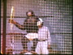1960s MS Chimp performing tricks in cage in Jungle Land / Thousand Oaks, California, USA