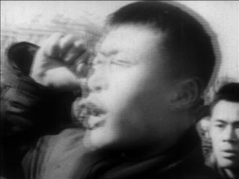B/W 1960s close up Chinese man shouting raising fist during demonstration / China / educational