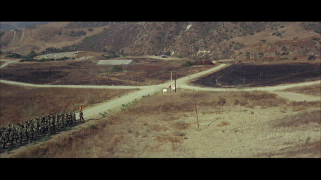 1960s LS WS HA Groups of soldiers marching in training field