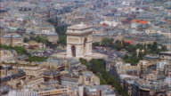1960s high angle wide shot Arc de Triomphe and traffic / Paris, France