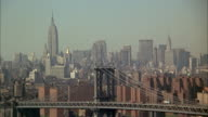1960s WS HA Manhattan skyline with Manhattan Bridge in foreground / New York City, USA