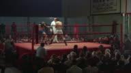 1960s WS Men fighting in boxing ring