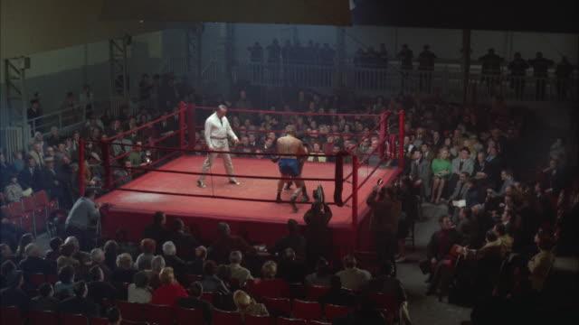 1960s WS HA Men fighting in boxing ring
