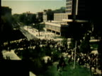 1960s MONTAGE Large group of people gathered in city park for antiVietnam War demonstration / United States