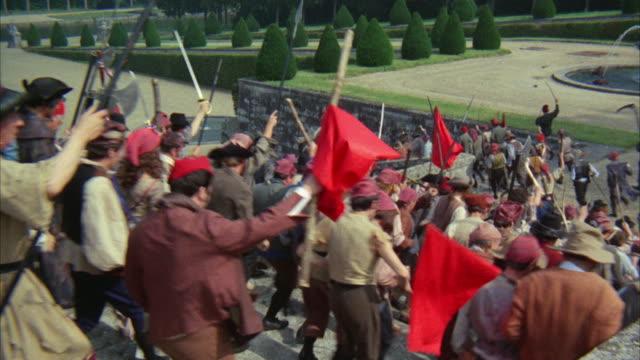 1960s WS Peasant mob rushing down palace steps