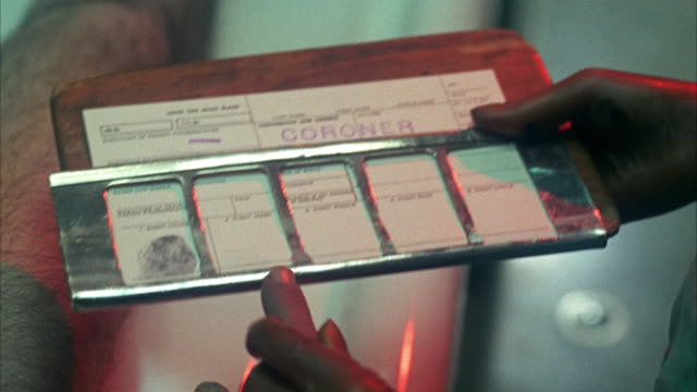 1960s CU Person being fingerprinted on coroner's card