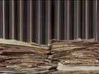 1960s time lapse medium shot paper stacking up on desk