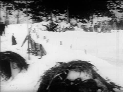 B/W 1960s PAN tobogganer wiping out flying thru air / Villach Austria / educational