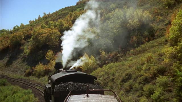 1960s WS HA POV Train moving straight forward at 12 mph through mountainous country near Lobato / New Mexico, USA