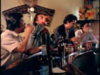 1970s MS Four men drinking beer in bar, Los Angeles, California, USA, AUDIO