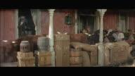 1970s WS Gunmen shooting at cattle charging at saloon porch