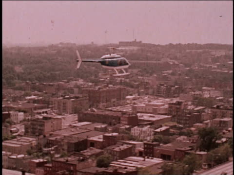 1970s MONTAGE Helicopter following hijackers below / Brooklyn, New York, United States