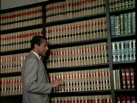 1970s MONTAGE Lawyer talking to teenage boy in office, Los Angeles, California, USA, AUDIO