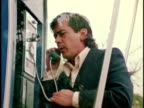 1970s MONTAGE Man calling operator from pay phone and being connected to fire department, Los Angeles, California, USA, AUDIO