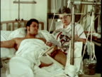 1970s MONTAGE Nurse and patient browsing magazine together Hospital, Los Angeles, California, USA, AUDIO