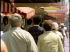 1970s MONTAGE Pedestrians on Los Angeles streets, California, USA, AUDIO