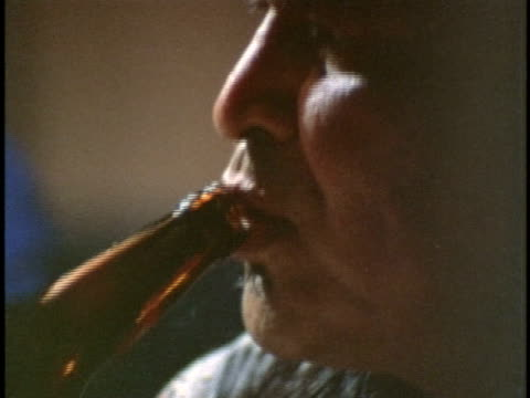 1970s MONTAGE CU People drinking alcohol at bar, Los Angeles, California, USA, AUDIO
