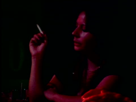 1970s MONTAGE CU People drinking alcohol in night club, Los Angeles, California, USA, AUDIO