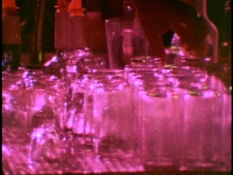 1970s MONTAGE People in bar at night, Los Angeles, USA, California, AUDIO