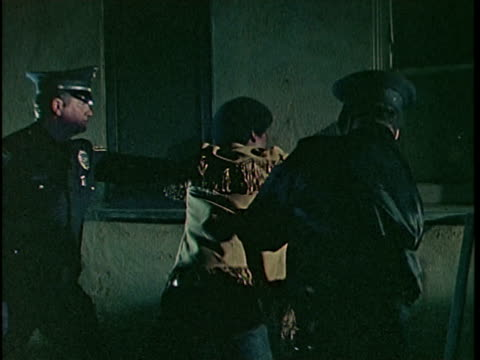 1970s MONTAGE Two police officers catching burglar at night, Los Angeles, California, USA, AUDIO