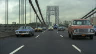 1970s WS REAR POV Traffic on George Washington Bridge / New York City, USA