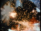 1970s slow motion low angle close up space shuttle rockets firing up sparks flying around / educational